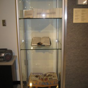 Case containing Journals and Moon Scrap Book, a Chicago telephone book with collaged moon images salvaged from comics, advertising, and other media.